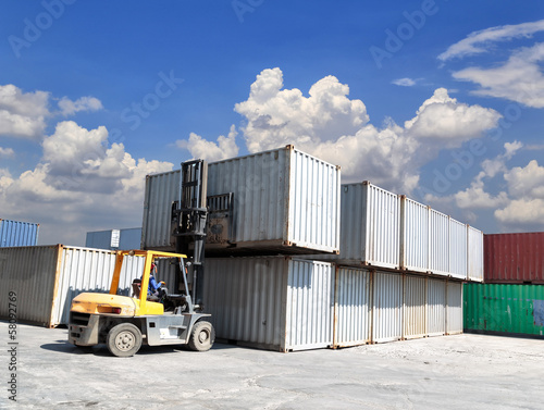 forklift handling the container box at dockyard