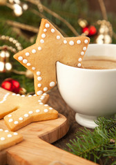 Cup of coffee with milk and christmas sugar cookies