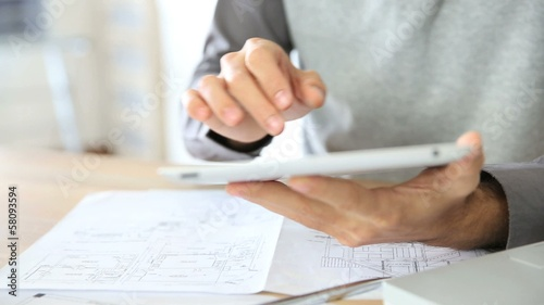 Man at work using digital tablet