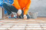 Worker, rebar gridwork across a floor for strength poster