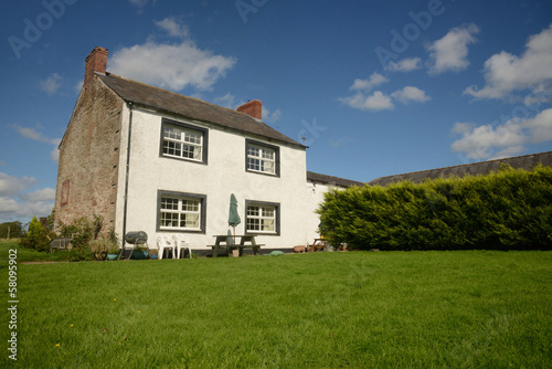 Country farm house with lawn