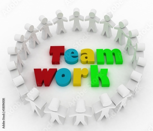 People stand around a word teamwork