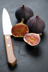 Vertical shot of whole and sliced fig fruits