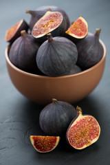 Ceramic bowl with ripe figs, vertical shot, close-up