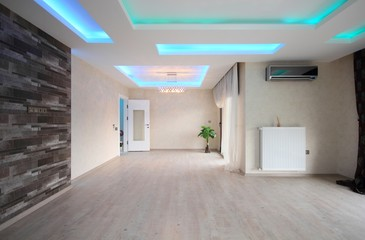 Empty living room with concealed lighting
