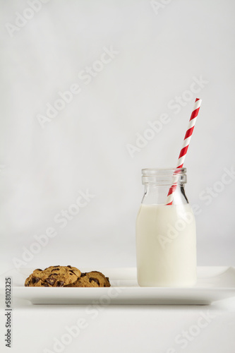 Leinwandbild Motiv Milk and cookies for Santa Claus on Christmas night vertical