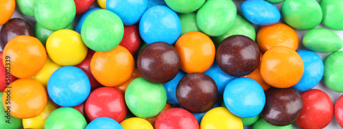 Backgroynd of chocolate balls in colorful glaze.