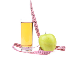 Apple fruit and juice with measure tape.