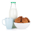 Cup, bottle of milk and bowl with cookies