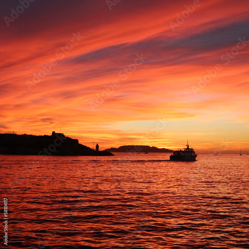 Cruise ship in port of Marseille at sunset - France