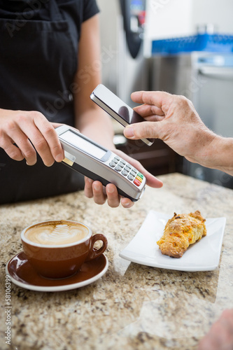 Customer Paying using NFC