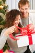 Happy Couple Opening Christmas Gift. Christmas Family