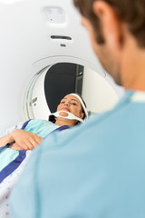 Patient Looking At Nurse While Undergoing CT Scan