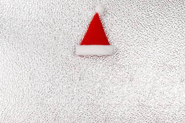 santa claus hat over silver metal plate - Xmas theme