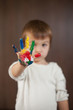 Boy with painted hand