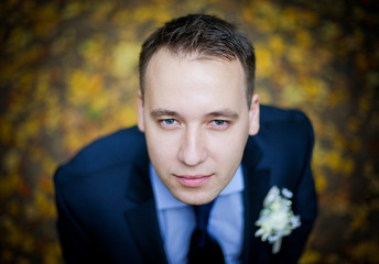 Beautiful portrait of the bridegroom on the wedding day