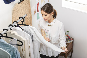 Fashion woman choosing a piece for the new collection.