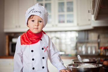 Little boy, baking muffins