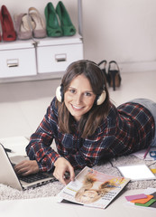 Blogger woman working with laptop and magazine in fashion office