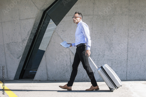 Businessman walking with bag to the convention.