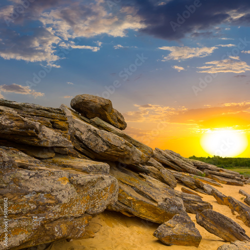 stony desert at the sunset