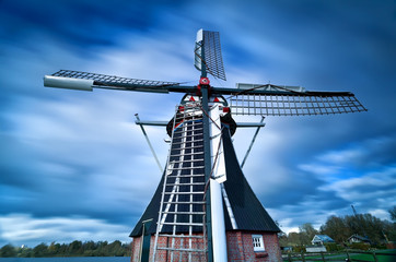 Dutch windmill and clouded sky