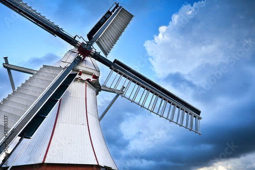white Dutch windmill over blue sky