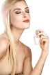 elegant woman applying perfume on her body