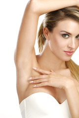 beautiful woman showing her perfectly shaved armpit