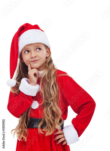 Thinking girl in christmas outfit