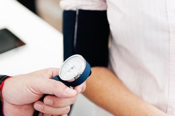 At pharmacy: check one's blood pressure