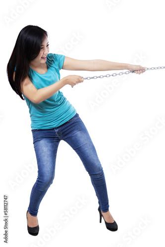 Beautiful woman pulling the chain