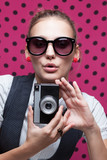 trendy girl posing during a taking selfie. Duckface poster