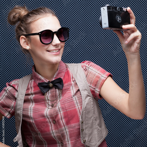 trendy girl posing during a taking selfie