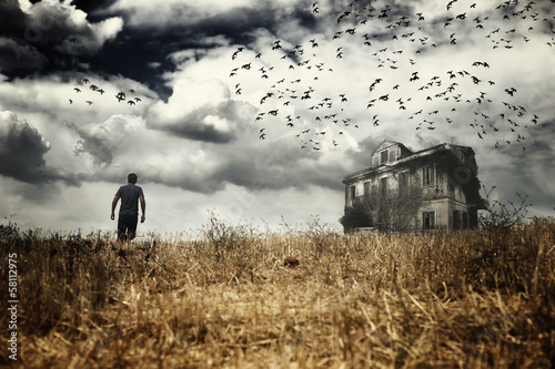 Man walking  in a spooky scenery