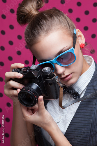 Hipster girl taking a photo