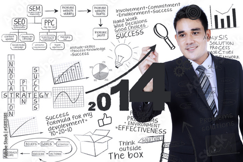 Businessman writing a business concept