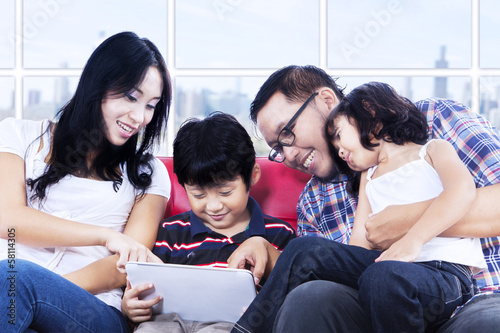 Family quality time using touchpad at apartment