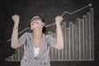 Happy businesswoman with growth graph