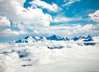 Paraglider flying against the Himalayas-Everest region