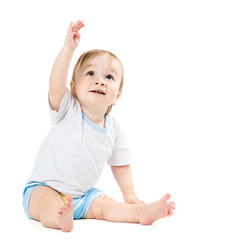 baby sitting and points his hand up