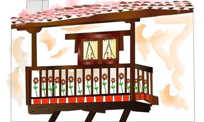 Casa con balcón y flores