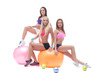 Charming trio of young athletes posing in studio