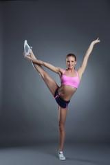 Charming flexible athlete doing vertical split