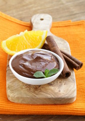 dessert of chocolate mousse (melted chocolate) with orange
