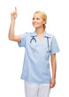 smiling doctor or nurse pointing to something