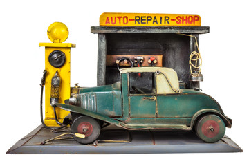 Retro toy car repair shop isolated on white