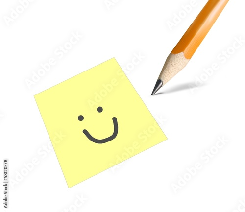 Smile drawn on a yellow post it card