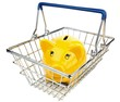 A yellow smiling piggy bank in a shopping basket