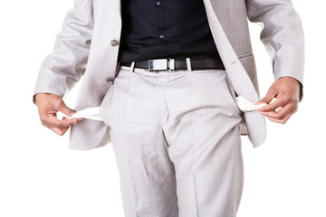 Male businessman showing open pockets.